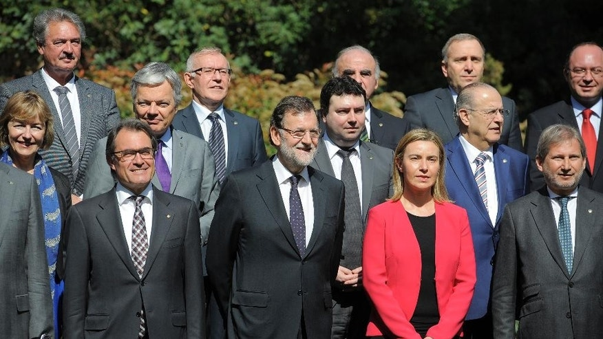 President Spanish Primer Minister Mariano Rajoy, center, and Catalan regional government Artur Mas, left, pose for the media with foreign ministers before the informal ministerial meeting in Barcelona, Spain, Monday April 13, 2015. Foreign ministers from European and North African countries have gathered in Barcelona to discuss ways to fight terrorism and illegal immigration. Europe has been hit by increasing waves of migration from Syrians and sub-Saharan Africans crossing the Mediterranean in flimsy boats in a bid to get to Europe. (AP Photo/Manu Fernandez)