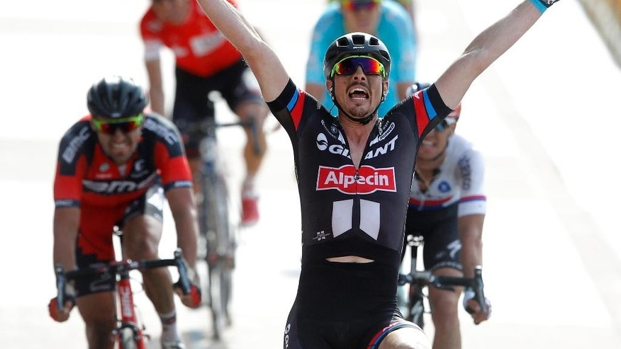 Giant Team's John Degenkolb of Germany wins the 113th edition of the Paris-Roubaix cycling classic, a 253,5 kilometer (157,51 mile) one day race, of which 51,1 kilometers (31,7 miles) are run on cobblestones, at the velodrome in Roubaix, northern France, on Sunday, April 12, 2014. (AP Photo/Michel Spingler)
