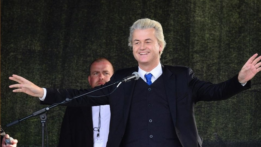 Geert Wilders, leader of the Dutch anti-Islam Freedom Party reacts at a rally of so-called 'Patriotic Europeans against the Islamization of the West' (PEGIDA) in Dresden, Germany, Monday, April 13, 2015. (AP Photo/Jens Meyer)