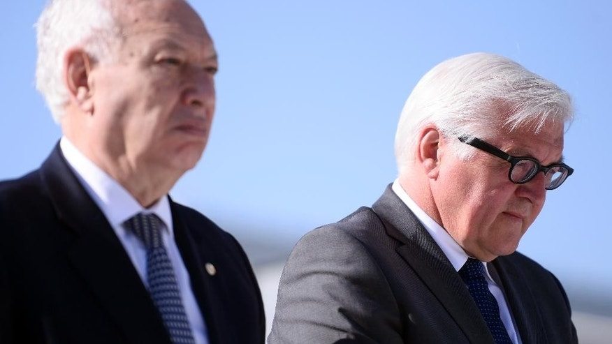 Spanish Foreign Minister Manuel Garcia Margallo, left, and German Foreign Minister Frank-Walker Steinmeier observe a minute of silence in commemoration of the victims of the Germanwings Airbus A320 crash on March 24, 2015 in the French Alps, at the airport of Barcelona, Spain, Monday April 13, 2015. The foreign ministers of Spain, France and Germany have attended a wreath-laying ceremony at Barcelona's airport in memory of the 150 victims of the Germanwings plane crash last month. (AP Photo/Manu Fernandez)