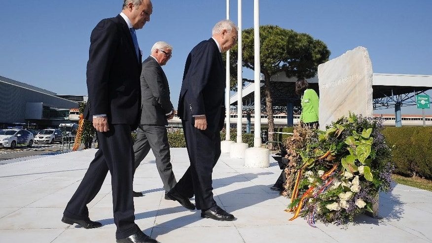 French Foreign Minister Laurent Fabius, left, Spanish Foreign Minister Manuel Garcia Margallo, right, and German Foreign Minister Frank-Walker Steinmeier attend a ceremony in commemoration of the victims of the Germanwings Airbus A320 crash on March 24, 2015 in the French Alps, at the airport of Barcelona, Spain, Monday April 13, 2015. The foreign ministers of Spain, France and Germany have attended a wreath-laying ceremony at Barcelona's airport in memory of the 150 victims of the Germanwings plane crash last month. (AP Photo/Manu Fernandez)