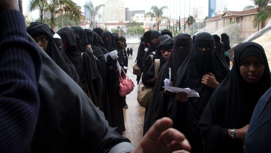 April 5, 2015: Kenyan Muslim women wait in a queue to be checked by security at Kenyatta International Conference Centre during the Islamic Conference in Nairobi. (AP Photo/Sayyid Azim)