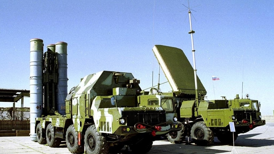 FILE - In this undated file photo a Russian S-300 anti-aircraft missile system is on display at an undisclosed location in Russia. The Kremlin says Russia has lifted its ban on the delivery of a sophisticated air defense missile system to Iran. Russia signed the $800 million contract to sell Iran the S-300 missile system in 2007, but later suspended their delivery because of strong objections from the United States and Israel. The decree signed Monday, April 13, 2015, by President Vladimir Putin allows for the delivery of the missiles. (AP Photo/File)