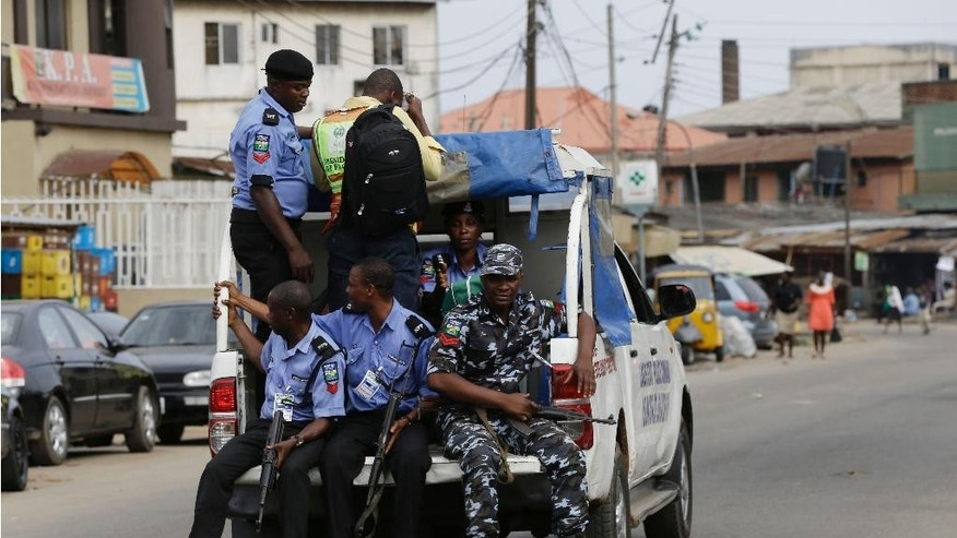 Nigeria Police transport election results at the end of voting in one of the polling station  in Lagos, Nigeria, Saturday, April 11, 2015. Nigeria goes to the polls Saturday to elect governors and state Assembly.(AP Photo/Sunday Alamba)
