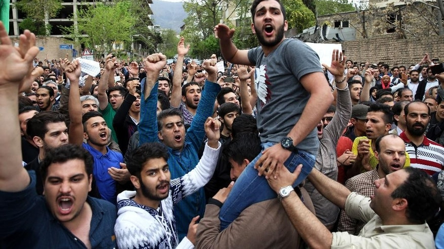 "Iranian protesters chant slogans in front of the Saudi Embassy in Tehran, Iran, Saturday, April 11, 2015. Defying a government ban, hundreds of Iranians protested over two male Iranian pilgrims who alleged abuse after Saudi officers at Jeddah's international airport searched them. Demonstrators shouted: ""Shame on you!"" and ""Death to House of Saud!"" in reference to the Saudi ruling family. Details of the abuse have not been made public though Iran formally has called for the Saudi officers to be punished. (AP Photo/Ebrahim Noroozi)"