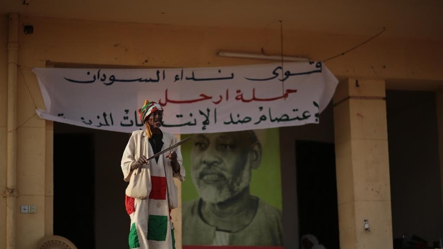 A man takes part during a sit-in at the headquarters of Umma, one of Sudan's biggest opposition parties, calling for boycotting the elections, on the eve of the presidential elections where longtime autocratic President Omar al-Bashir is expected to secure easy victory, in Khartoum, Sudan, Sunday, April 12, 2015. (AP Photo/Mosa'ab Elshamy)