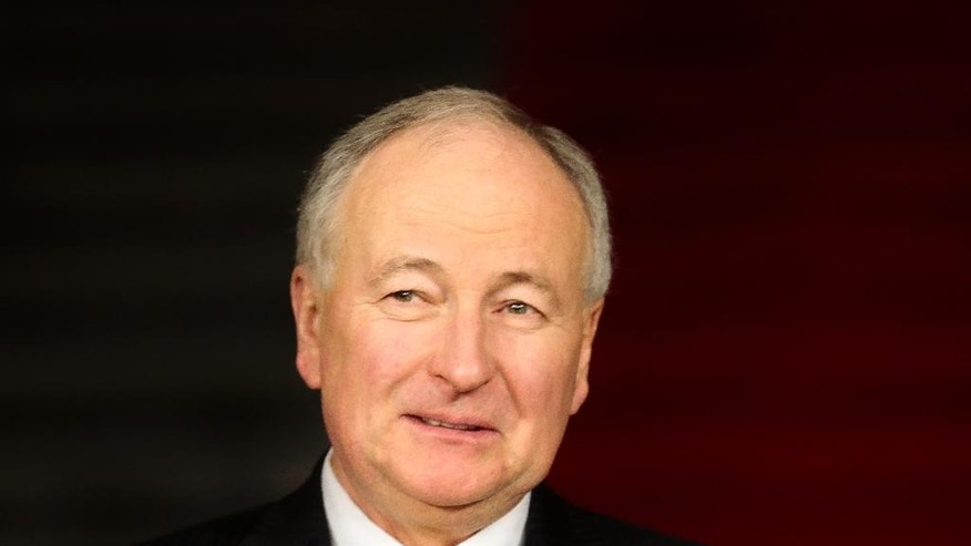 Canadian Foreign Minister Rob Nicholson smiles as he arrives for a meeting of the G7 Foreign ministers in Luebeck, northern Germany, Tuesday, April 14, 2015. The meeting is being held as preparation of the G7 leaders summit in Germany from June 7 to 8, 2015. (AP Photo/Markus Schreiber, Pool)