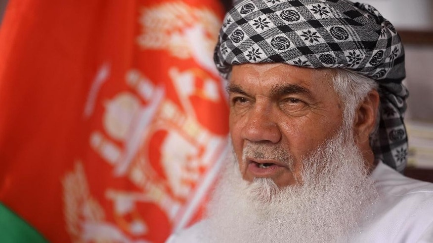 In this Sunday, April 12, 2015 photo, Ismail Khan, long dominant figure in Afghanistan's western province of Herat, speaks during an interview with The Associated Press in Herat city, west of capital Kabul. Afghanistan could face a war with the Islamic State group if the government does not resolve internal differences and improve the security situation, one of the country's most powerful warlords warned in an interview with the AP. (AP Photo/Massoud Hossaini)