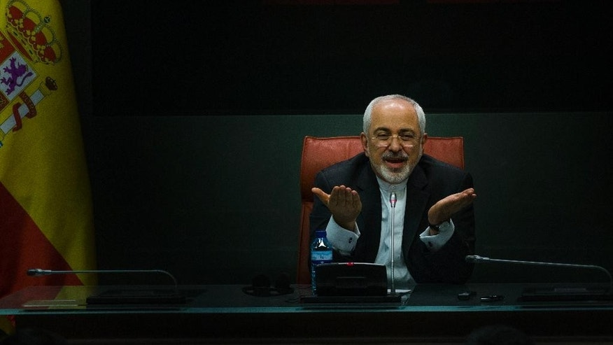 Iranian Foreign Minister Mohammad Javad Zarif  speaks during a press conference with his Spanish counterpart Manuel Garcia Margallo in Madrid,  Spain, Tuesday, April 14, 2015. (AP Photo/Andres Kudacki)