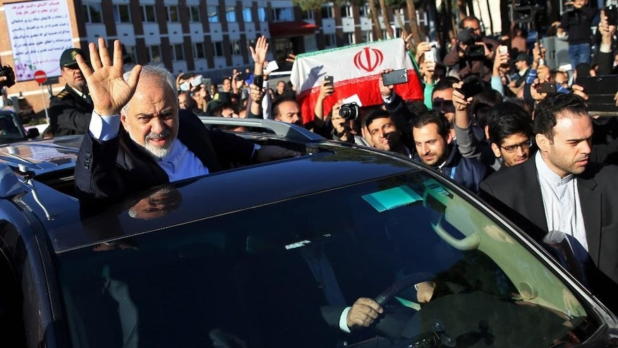 FILE - In this April 3, 2015 file photo, Iranian Foreign Minister Mohammad Javad Zarif, who is also Iran's top nuclear negotiator, waves to his well wishers upon arrival at the Mehrabad airport in Tehran, Iran, from Lausanne, Switzerland. The potentially path-breaking deal on Iran's nuclear program could face political troubles in the Islamic Republic and the United States, but not necessarily elsewhere. Other world powers that signed on to a framework deal this month _ Britain, China, France, Germany, Russia _ are not likely to face major domestic obstacles to the deal. (AP Photo/Ebrahim Noroozi, File)