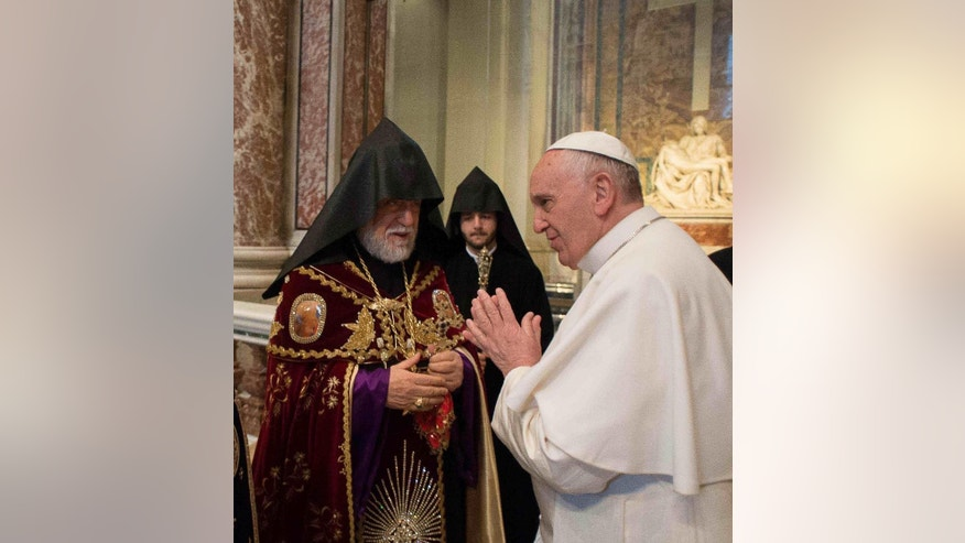 April 12, 2015: Pope Francis, right, is greeted by Catholicos Aram I, left, during an Armenian-Rite Mass in St. Peter's Basilica, at the Vatican.