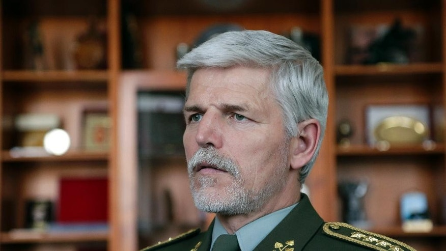 Gen. Petr Pavel, new head of NATO's Military Committee, answers a question during an interview with The Associated Press in Prague, Czech Republic, Wednesday, April 15, 2015. Pavel said that the western military alliance has to convince the public it has the means and will to confront Russia. (AP Photo/Petr David Josek)