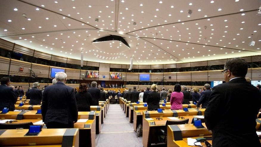 Members of European Parliament stand for a moment of silence at the European Parliament in Brussels on Wednesday, April 15, 2015. MEP's on Wednesday will discuss the Multi-annual Financial Framework for 2014-2020, the anniversary of the Bangladesh factory fire and an estimated 1.5 million Armenians who were killed by Ottoman Turks around the time of World War I. (AP Photo/Virginia Mayo)