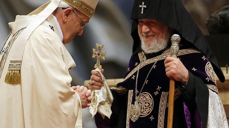 "Pope Francis, center, is greeted by the head of Armenia's Orthodox Church Karekin II, right, during an Armenian-Rite Mass  in St. Peter's Basilica, at the Vatican, Sunday, April 12, 2015. Pope Francis on Sunday called the slaughter of Armenians by Ottoman Turks ""the first genocide of the 20th century"" and urged the international community to recognize it as such, sparking a diplomatic rift with Turkey. Turkey, which has long denied a genocide took place, immediately summoned the Vatican ambassador to complain and promised a fuller official response. (AP Photo/Gregorio Borgia)"