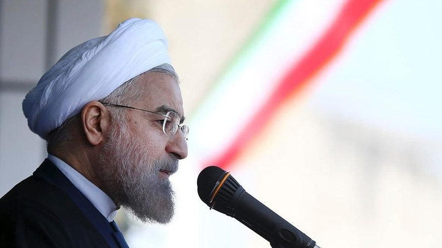 In this photo released by the official website of the office of the Iranian Presidency, Iran's President Hassan Rouhani delivers his speech in a public gathering in the city of Rasht during his tour to the northern province of Gilan, Iran, Wednesday, April 15, 2015. Iranian President Hassan Rouhani on Wednesday dismissed pressure from the U.S. Congress over a preliminary deal on Iran's nuclear program, saying that Tehran is dealing with world powers — not American lawmakers. (Mohammad Berno, Iranian Presidency Office via AP)