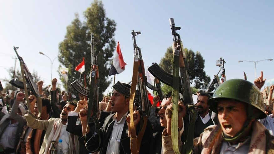 Shiite rebels, known as Houthis, chant slogans during a demonstration against an arms embargo imposed by the U.N. Security Council on Houthi leaders, in Sanaa, Yemen, Thursday, April 16, 2015. Al-Qaida's branch in Yemen seized Thursday control of a major airport and sea port and oil terminal in southern Yemen, consolidating their hold of the country's largest province amid wider chaos that is pitting Shiite rebels against forces loyal to the country's exiled president and a Saudi-led air campaign. (AP Photo/Hani Mohammed)