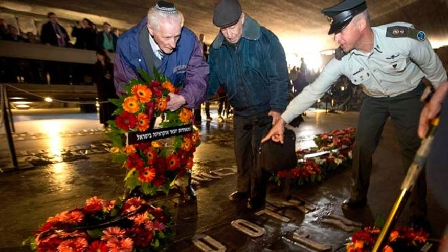 April 16, 2015: Holocaust survivors and their relatives lay a wreath next to the names of concentration camps during a ceremony marking the annual Holocaust Remembrance Day at the Hall of Remembrance at the Yad Vashem Holocaust memorial, in Jerusalem.