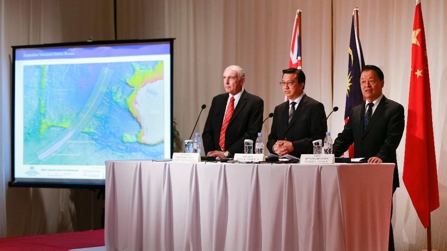 "From left to right, Australian Deputy Prime Minister Warren Truss, Malaysian Transport Minister Liow Tiong Lai and Chinese Minister of Transport Yang Chuantang attend a press conference following their meeting in Kuala Lumpur, Malaysia, Thursday, April 16, 2015. The search area for the missing Malaysia Airlines Flight 370 will be expanded by another 60,000 square kilometers (23,000 square miles) in the Indian Ocean if the jetliner is not found by May, officials said Thursday. Liow told reporters that the three countries, which are leading the hunt for the Boeing 777 that went missing on March 8 last year, are ""committed to the search."" (AP Photo/Vincent Thian)"