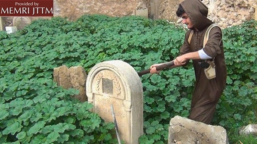 ISIS released images on Thursday that show members destroying Christian graves in the northern Iraqi city of Mosul. (courtesy of MEMRI)