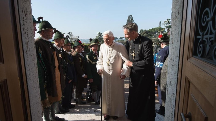 April 16, 2015: Pope Emeritus Benedict XVI, left, is flanked by Monsignor Georg Gaenswein as he celebrates his 88th birthday with members of a group from his hometown Bavaria region, in the pontiff's Castel Gandolfo residence, in the hills overlooking Rome.