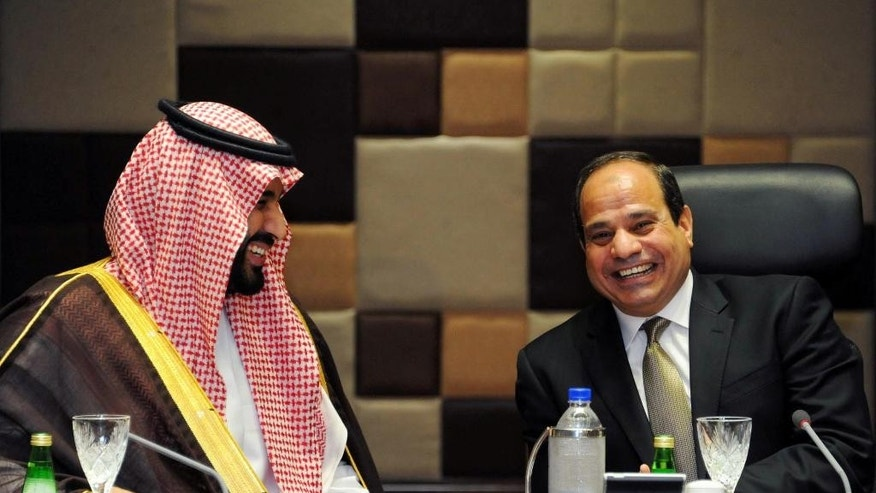 FILE - In this, Tuesday, April 14, 2015, file photo, provided by the office of the Egyptian Presidency, Egyptian President Abdel-Fattah el-Sissi, right, meets with Saudi Defense Minister Mohammed bin Salman at the Presidential Palace in Cairo, Egypt. Saudi Arabia's government insists it is not at war with Iran despite its three-week air campaign against Tehran-backed rebels in Yemen, but the kingdom's powerful clerics, and its regional rival's theocratic government, are increasingly presenting the conflict as part of a region-wide battle for the soul of Islam. (Egyptian Presidency via AP, File)