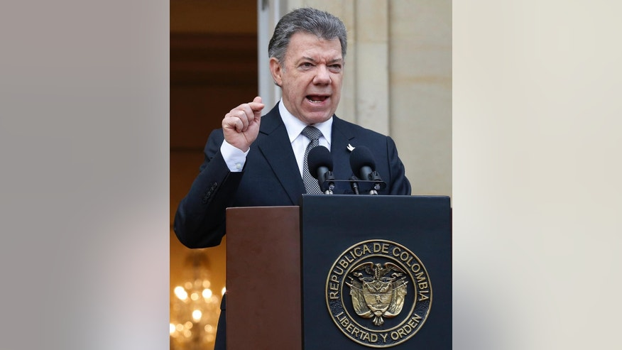 Colombia's President Juan Manuel Santos speaks to the media after a welcoming ceremony for South Korea's President Park Geun-hye at the presidential palace in Bogota, Colombia, Friday, April 17, 2015. In a sharply worded rebuke, Santos said Colombians' patience is wearing thin after guerrillas this week attacked an army platoon sleeping in the field and killed 11 soldiers.  (AP Photo/Fernando Vergara)