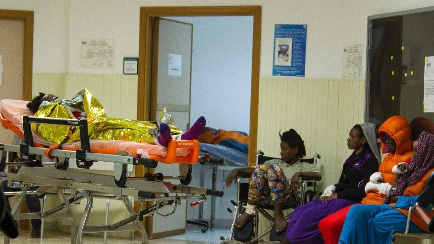 Injured women wait to be treated in the hospital of Lampedusa Island, Southern Italy, Friday, April 17, 2015. According to rescuers the women were injured in the explosion of a gas cylinder before leaving for Italy. An unprecedented wave of migrants has headed for the European Union's promised shores over the past week, with 10,000 people making the trip.  (AP Photo/Mauro Buccarello)