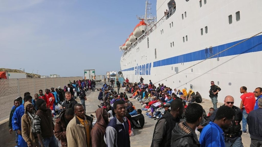 Migrants are waiting to board on a cruise ship as they leave the Island of Lampedusa, Southern Italy, to be transferred in Porto Empedocle, Sicily, Friday, April 17, 2015.  An unprecedented wave of migrants has headed for the European Union's promised shores over the past week, with 10,000 people making the trip. Hundreds ó nobody knows how many ó have disappeared into the warming waters of the Mediterranean, including 41 migrants reported dead Thursday after a shipwreck. (AP Photo/Francesco Malavolta)