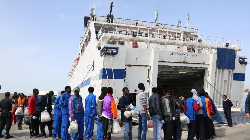 Migrants board on a ferry as they leave the Island of Lampedusa, Southern Italy, to be transferred in Porto Empedocle, Sicily, Friday, April 17, 2015.  An unprecedented wave of migrants has headed for the European Union's promised shores over the past week, with 10,000 people making the trip. Hundreds — nobody knows how many — have disappeared into the warming waters of the Mediterranean, including 41 migrants reported dead Thursday after a shipwreck. (AP Photo/Francesco Malavolta)