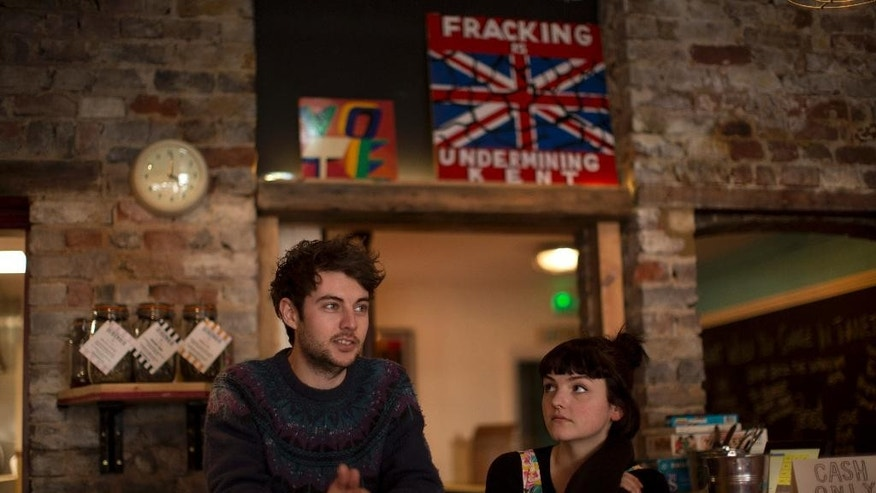 Activists from the Reality Party Daisy Warne and Tom Batterbee, both aged 24, speak to The Associated Press as they are interviewed in their Evolution Cafe in Ramsgate, England, Tuesday, March 31, 2015.  (AP Photo/Matt Dunham)