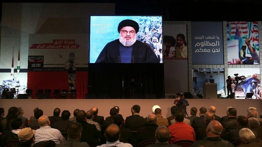 "Hezbollah leader Sheikh Hassan Nasrallah, speaks via video link to his supporters during a rally titled ""in solidarity with oppressed Yemen"" in the southern suburb of Beirut, Lebanon, Friday, April 17, 2015. The leader of Lebanon's militant Hezbollah group has launched his harshest criticism yet of Saudi Arabia, blaming the kingdom for the spread of extremist ideology in the Muslim world and the killing of civilians in Yemen. (AP Photo/Bilal Hussein)"