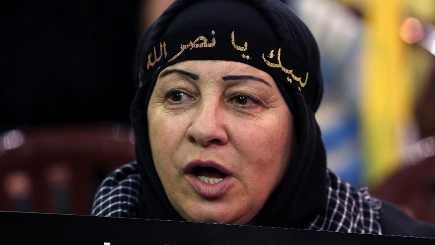 "A Hezbollah supporter holds a placard in Arabic that reads ""aggression against Yemen,"" as she listens to Hezbollah leader Sheik Hassan Nasrallah during a rally titled ""in solidarity with oppressed Yemen"" in the southern suburb of Beirut, Lebanon, Friday, April 17, 2015. Nasrallah launched his harshest criticism yet of Saudi Arabia, blaming the kingdom for the spread of extremist ideology in the Muslim world and the killing of civilians in Yemen. (AP Photo/Bilal Hussein)"
