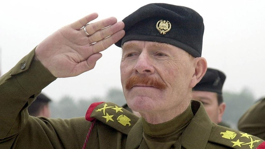 FILE - in this Sunday, Dec. 1, 2002 file photo, Iraqi Vice chairman of the Revolutionary Command Council, Izzat Ibrahim al-Douri salutes during a ceremony at the Martyrs Monument in Baghdad, Iraq. Salahuddin province Gov. Raed al-Jabouri says soldiers and allied Shiite militiamen killed al-Douri early Friday, April 17, 2015 in an operation east of the city of Tikrit. A graphic photo issued by the government purports to be of al-Douri's corpse, but DNA tests are still pending. (AP Photo/Jassim Mohammed, File)