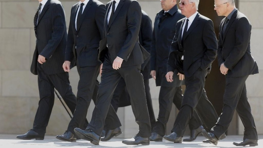 Lufthansa CEO Carsten Spohr, second left, and Germanwings CEO Thomas Winkelmann, third left, arrive at the Cologne Cathedral in Cologne, Germany, Friday, April 17, 2015. A mourning ceremony will be held in the Cathedral  in memory of the 150 victims of the Germanwings plane crash last month in the French Alps.(AP Photo/Frank Augstein)