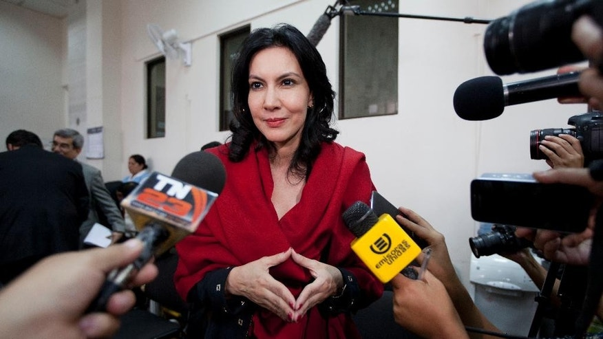 In this Jan. 5, 2015 photo, Zury Rios Sosa, the daughter of Guatemala's former dictator Efrain Rios Montt, talks with reporters as she accompanies her father to court where he faces charges of genocide and crimes against humanity, in Guatemala City. Zury Rios Sosa, a three-time member of congress, announced Thursday, April 16, 2015 that she would accept the nomination of the Christian conservative Vision with Values party to run for president in general elections later this year. (AP Photo/Moises Castillo)
