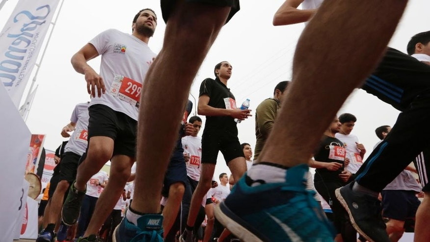 In this Friday, April 17, 2015 photo, Egyptian runners participate in Cairo's annual Half Marathon in the Heliopolis district in Cairo, Egypt, Friday, April 17, 2015. Cairo, a city of some 20 million people packed onto the banks of the Nile, with few green spaces and no jogging paths, is an unlikely venue for distance running. (AP Photo/Amr Nabil)