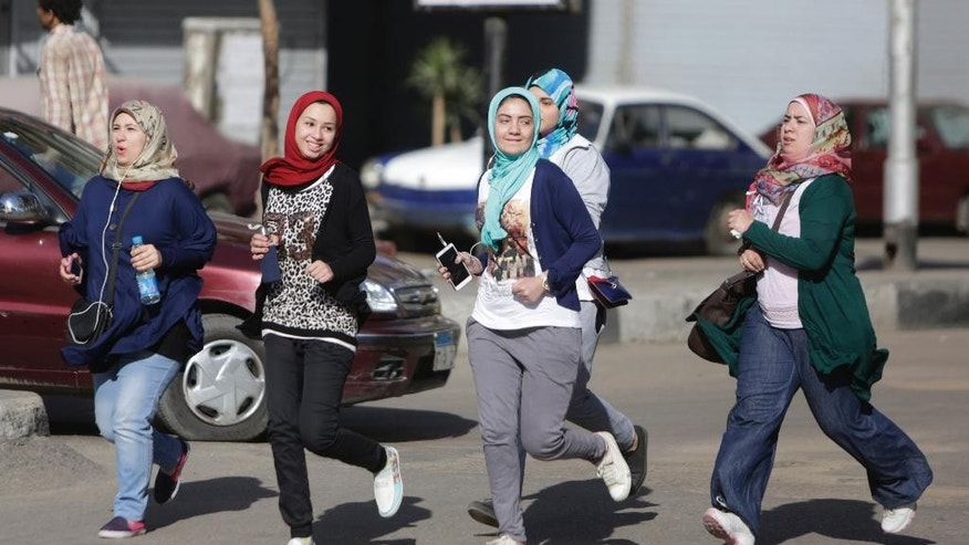 FILE - In this Friday, April 10, 2015 file photo, young Egyptian women run in the Mohandiseen district in Cairo, Egypt. (AP Photo/Amr Nabil, File)