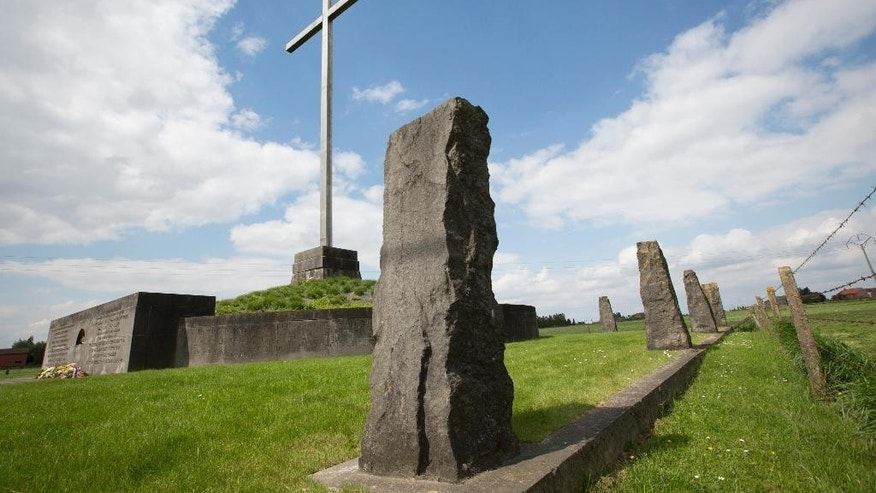 In this Saturday, May 3, 2014 file photo, a memorial surrounded by standing stones commemorates those who lost their lives as a result of the first gas attacks during World War I in Steenstrate, Belgium. The cross marks the fields where troops faced the first use of poison gas during World War I on April 22, 1915. Chlorine gas - sent crawling in favorable winds over Flanders Fields from German positions - sowed terror and agony for the first time on April 22, 1915. The era of chemical weaponry had dawned. The weapon of mass slaughter came to symbolize the ruthlessness and, many say, futility of the 1914-1918 Great War.  (AP Photo/Virginia Mayo, File)