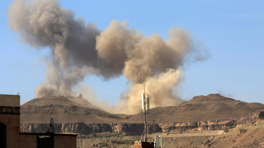 "In this photo take on Friday, April 17, 2015, smoke rises after a Saudi-led airstrike on Sanaa, Yemen.  Iran's foreign minister urged U.N. Secretary-General Ban Ki-moon on Friday to try to end ""the senseless aerial attacks"" in Yemen by a Saudi-led coalition and establish a cease-fire.  (AP Photo/Shohdi Alsofi)"