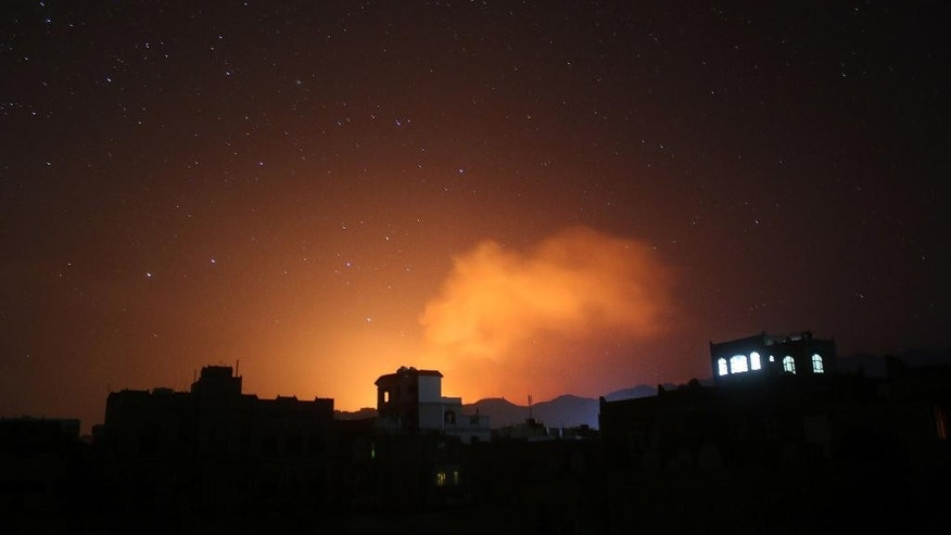 "In this photo taken on Friday, April 17, 2015, fire and smoke rises after a Saudi-led airstrike on Sanaa, Yemen.  Iran's foreign minister urged U.N. Secretary-General Ban Ki-moon on Friday to try to end ""the senseless aerial attacks"" in Yemen by a Saudi-led coalition and establish a cease-fire. (AP Photo/Shohdi Alsofi)"