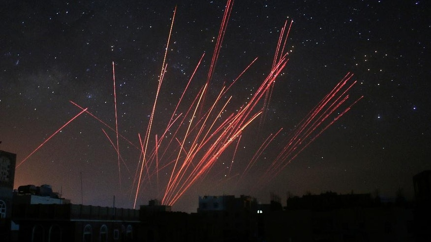 "In this photo taken on Friday, April 17, 2015, the sky over Sanaa is illuminated by anti-aircraft fire during a Saudi-led airstrike in Yemen.  Iran's foreign minister urged U.N. Secretary-General Ban Ki-moon on Friday to try to end ""the senseless aerial attacks"" in Yemen by a Saudi-led coalition and establish a cease-fire. (AP Photo/Shohdi Alsofi)"