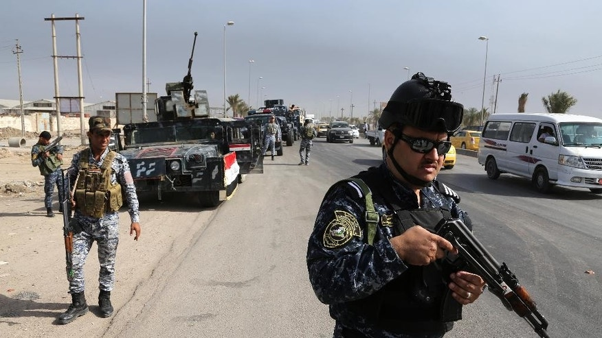 Iraqi security troops head to Ramadi on the orders of Prime Minister Haider al-Abadi to re-enforce troops there, Baghdad, Iraq, Saturday, April 18, 2015. Thousands of displaced people form Ramadi city continue to pour to Baghdad, fleeing the ongoing fighting in Anbar provincial capital between Iraqi security forces and fighters from the Islamic State militant group.  (AP Photo/Karim Kadim)