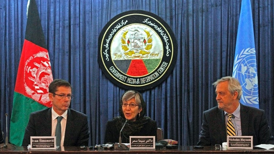 Chairperson of the Afghan Independent Human Rights Commission Sima Samar, center, U.N. Assistant Secretary-General for Human Rights, Ivan Simonovic, left, and Special Representative of the U.N. Secretary General for Afghanistan Nicholas Haysom give a press conference in Kabul, Afghanistan, Sunday, April 19, 2015. A U.N. report released Sunday said Afghanistan's women are being failed by the country's justice system as most complaints of domestic violence are dealt with by mediation rather than prosecution. (AP Photo/Allauddin Khan)