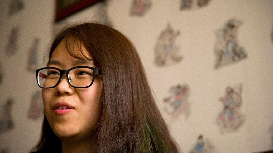 In this April 18, 2015 photo, the girlfriend of Chinese activist Li Tingting, who wished to be identified only by her English name of Teresa, speaks during an interview in Beijing. Li, one of five recently released Chinese women's rights activists feels her dedication to activism has grown only stronger after spending 37 days in detention with interrogators who blew smoke onto her face and insulted her sexual orientation, her girlfriend and her lawyer said.(AP Photo/Mark Schiefelbein)