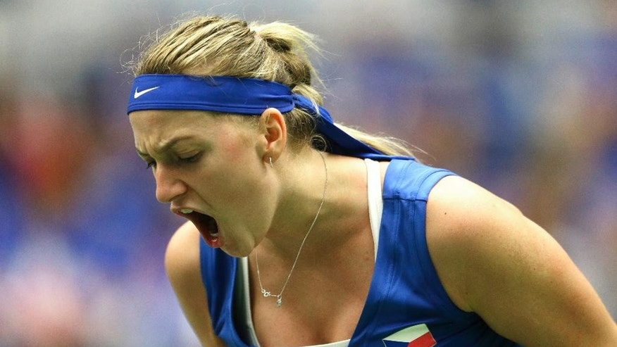 Petra Kvitova from Czech Republic reacts after winning a point against Kristina Mladenovic from France during the Fed Cup tennis semifinal match in Ostrava, Czech Republic, Saturday, April 18, 2015. Kvitova won the match in straight sets and gave Czech Republic a 2-0 lead. (AP Photo/Petr David Josek)