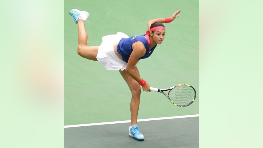 Caroline Garcia from France serves to Petra Kvitova from Czech Republic during the Fed Cup tennis semifinal match in Ostrava, Czech Republic, Sunday, April 19, 2015.  (AP Photo/Petr David Josek)
