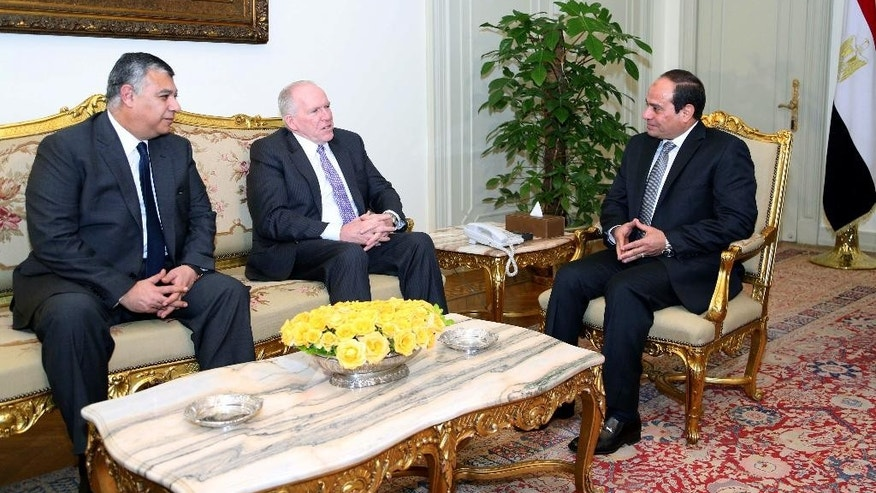 """In this image provided by the office of the Egyptian Presidency, Egyptian President Abdel-Fattah el-Sissi, right, meets with CIA director John Brennan, center, and the director of Egypt's General Intelligence Directorate Khaled Fawzy in Cairo, Sunday, April 19, 2015. A government statement Sunday said the meeting between Brennan and President Abdel-Fattah el-Sissi focused on """"ways of enhancing bilateral relations"""" and regional issues. It said both sides agreed to continue """"consultation and coordination on issues of mutual interest."""" (Egyptian Presidency via AP)"""