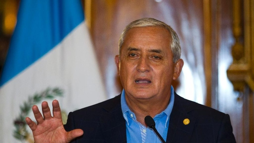 Guatemala's President Otto Perez Molina speaks about a recent corruption scandal during a press conference at the presidential house in Guatemala City, Friday, April 17, 2015. Guatemala's current and former tax chiefs were detained on Thursday along with more than a dozen other suspects in a crackdown on a ring that allegedly defrauded the state through corruption and theft. Authorities identified the alleged ringleader as Juan Carlos Monzon, private secretary to Vice President Roxana Baldetti. (AP Photo/Moises Castillo)