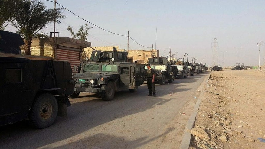 Iraqi anti-terrorism forces enter Ramadi from the eastern side, Iraq, Saturday, April 18, 2015. In Iraq's western Anbar province, Iraqi special forces maintained control of the provincial capital, Ramadi, after days of intense clashes with the Islamic State group left the city at risk. Sabah Nuaman, a special forces commander in Anbar, said the situation had improved after airstrikes hit key militant targets on the city's fringes. (AP Photo)