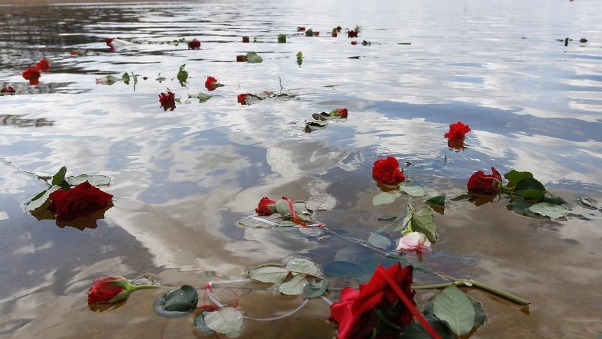 April 19, 2015: Flowers float in a lake after an event at the former Nazi concentration camp Ravensbrueck in Fuerstenberg, northeastern Germany, to commemorate  the 70th anniversary of the liberation of the camp by the Red Army on April 30, 1945.